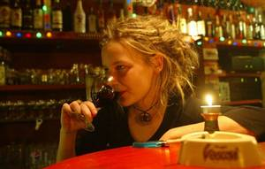 A young woman drinks a glass of wine in a bar in downtown Prague, Czech Republic (AP Photo)