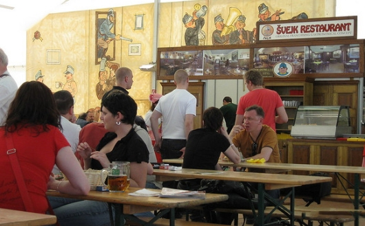 Food and beer being consumed at a restaurant in Prague.